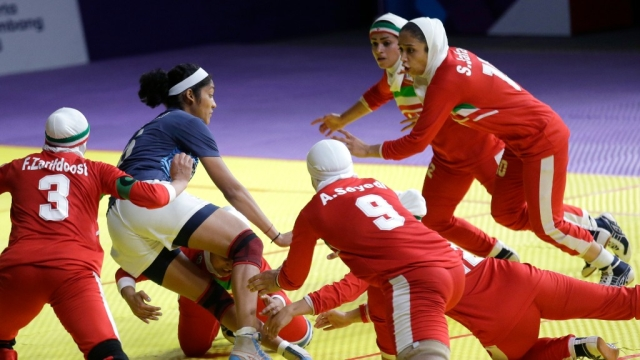 India's Sonali Shingate gets caught  between Iranian defenders.