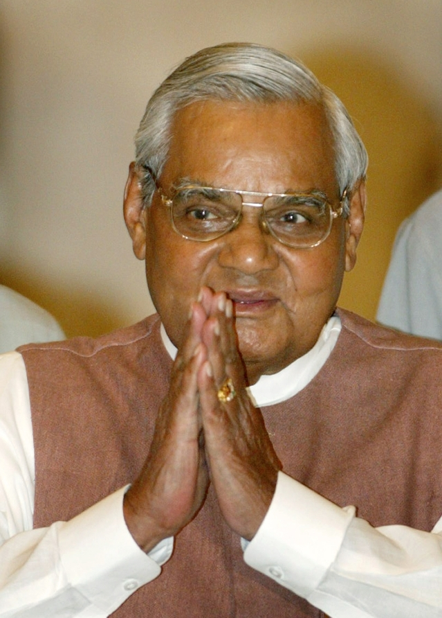 2 May, 2004 file photo,  Atal Bihari Vajpayee greets the audience as he arrives for a ceremony at the Presidential Palace.
