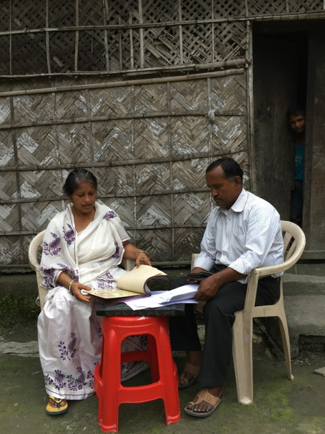Samsul Ahmed Haque and his wife going through the documents to claim their Indian citizenship.