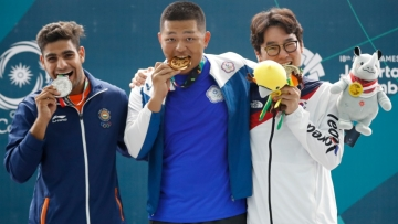 From left: Silver medalist India's Lakshay, gold medalist Taiwan's Yang Kunpi and bronze medalist South Korea's Ahn Daemyeong at the awards ceremony of the Men's trap shooting event at the 18th Asian Games on Monday.