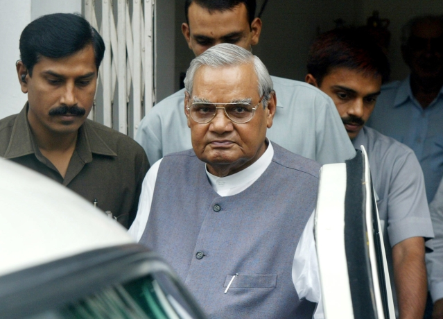 23 Aug, 2004 file photo, senior Bharatiya Janta Party (BJP) leader Atal Bihari Vajpayee, center, leaves after a meeting at the party headquarters in New Delhi.