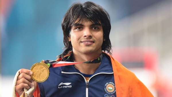 Jakarta: Gold medallist India's Neeraj Chopra poses for photographs at the medal ceremony of the men's javelin throw event during the 18th Asian Games 2018 in Jakarta, Indonesia.