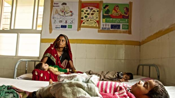 A lady waits for her child to be treated in a hospital.