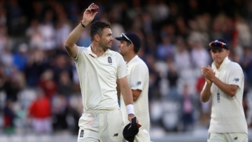 England's James Anderson holds up the ball to applause as he leaves the pitch after taking 5/20 against India on the second day of the second Test at Lord's on Friday.