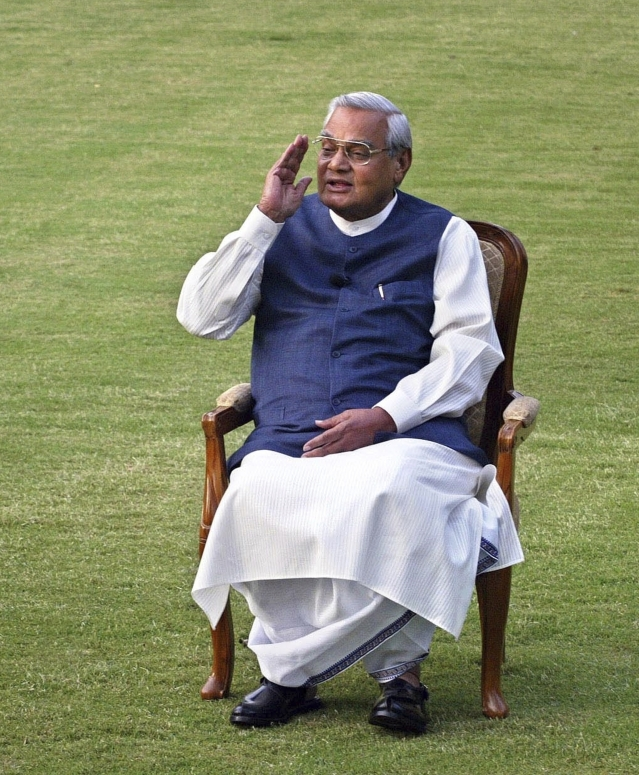 25 March, 2004 file photo, Indian Prime Minister Atal Bihari Vajpayee gestures during a photo session at his residence.