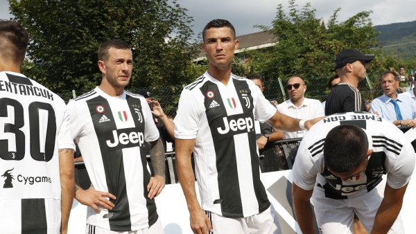 From left, Juventus' Federico Bernardeshi, Rodrigo Bentancur, Cristiano Ronaldo and Emre Can arrive to take part in a friendly match between the Juventus A and B teams, in Villar Perosa, northern Italy, Sunday, Aug.12, 2018.