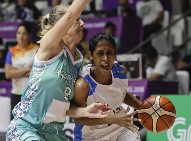 File picture of India's Prasannan Geetha in action against Kazakhstan's Mariya Astapenko during their women's basketball match at the 18th Asian Games in Jakarta, Indonesia on Friday, Aug. 17, 2018