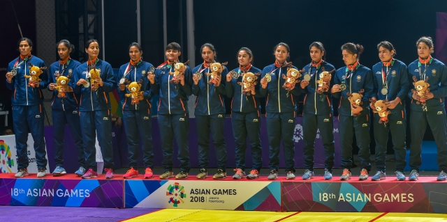 The Indian women's kabaddi team with their silver medal on the podium at the 2018 Asian Games.