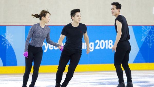 North Korea's Kim Ju Sik, right, skates next to South Korea's Kim Kyueun, left, and Kam Alex Kang Chan during a Pairs Figure Skating training session prior to the 2018 Winter Olympics in Gangneung, South Korea.