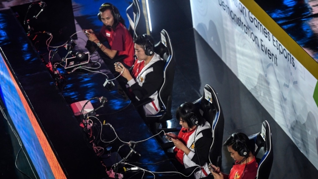Indonesian team compete in the eSports exhibition (Arena of Valor) at the 18th Asian Games.