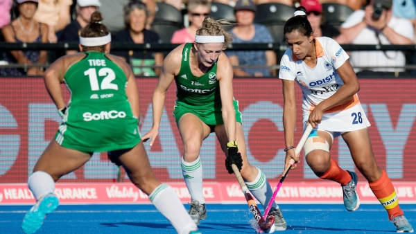 India's Rani Rampal vies for the ball against Ireland in the quarter-finals of the World Cup.