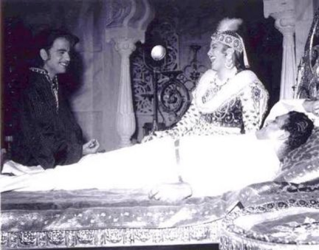 Dilip Kumar, Nigar Sultana and K Asif share a joke during a break while filming <i>Mughal-e-Azam</i> at Mohan Studio.