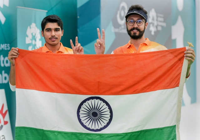 Indian shooters Gold medalist Saurabh Chaudhary (L) and Bronze medalist Abhishek Verma (R) after the 10m air pistol men's shooting at the  18th Asian Games Jakarta Palembang 2018.