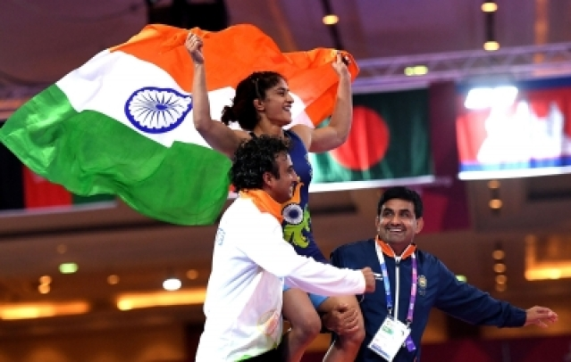 Vinesh (centre) celebrates after winning in Jakarta.