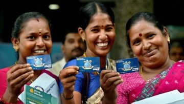 Women holding their Jan Dhan account cards.