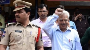 Maoist ideologue Varavara Rao being taken away by Maharashtra Police for his alleged involvement in a plot to assassinate Prime Minister Narendra Modi after his medical checkup at Gandhi Hospital, in Secunderabad, on 28 August.