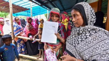 People wait to check their names on the final draft of the Assam NRC after it was released, at an NRC Seva Kendra in Nagaon on 30 July. Image used for representational purposes.