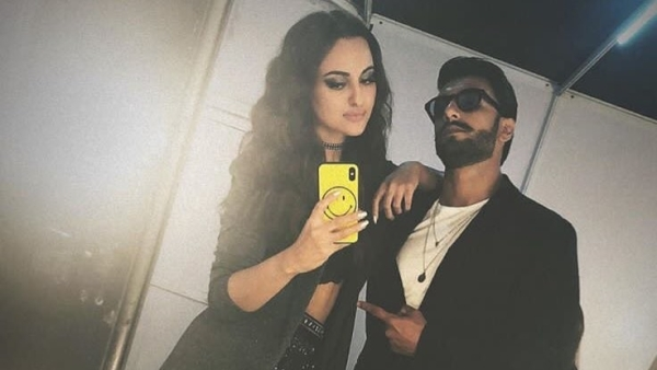 Sonakshi Sinha and Ranveer Singh take out a moment during the fashion event.