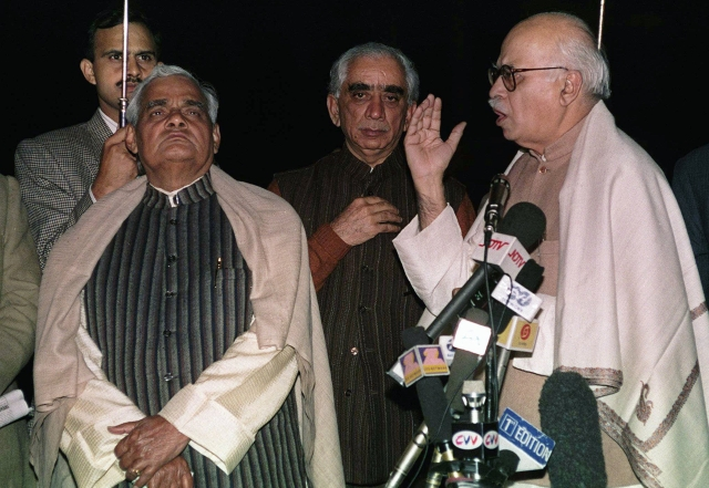 In this 30 Nov, 1997 file photo, Bharatiya Janata Party leaders LK Advani (R), Jaswant Singh (C) and Atal Bihari Vajpayee (L) address reporters after meeting with Indian President KR Narayanan.