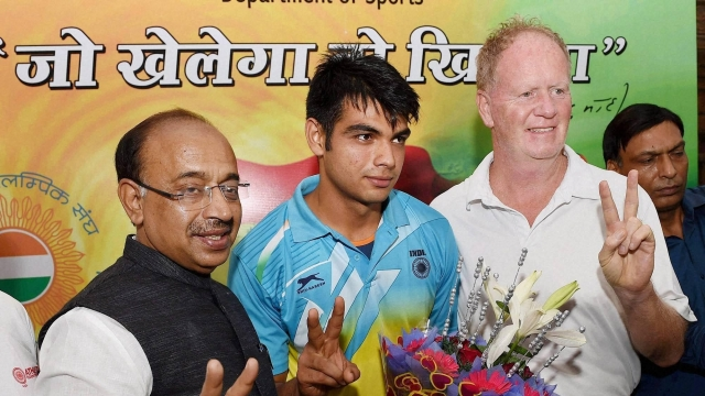 Neeraj with his old coach Gary Calvert at a felicitation ceremony in Delhi following his U20 World Championship win in 2016.