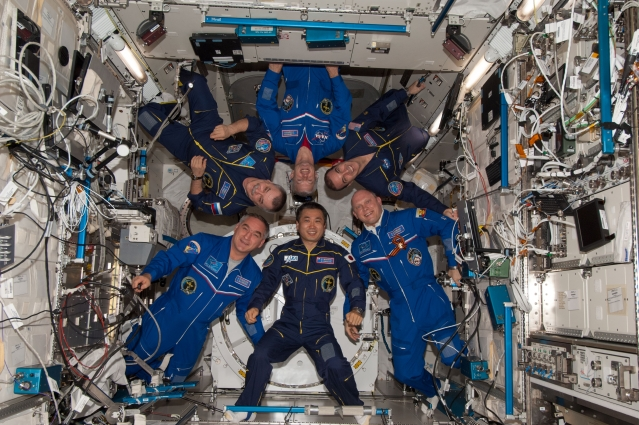 The crew members of Expedition 39, including Swanson, aboard the International Space Station.
