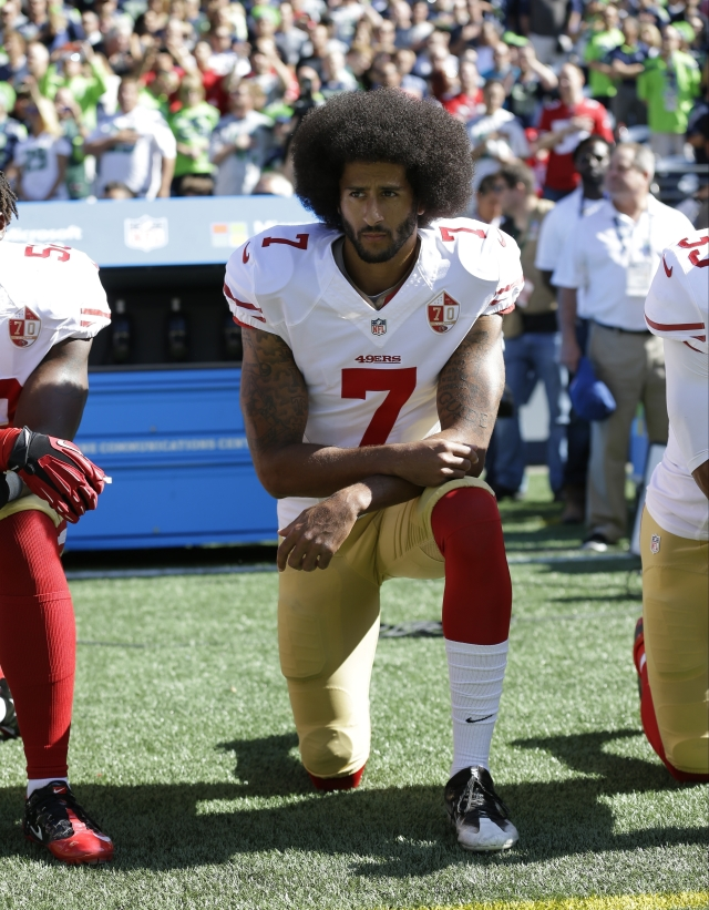 In this Sept. 25, 2016, file photo, San Francisco 49ers' Colin Kaepernick kneels during the national anthem before an NFL football game against the Seattle Seahawks, in Seattle.