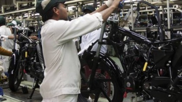 Employees work on the assembly line at the Honda Motorcycle & Scooter India Pvt plant in Manesar.