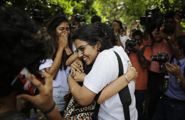 Supporters congratulate each other after the apex court's verdict in New Delhi.
