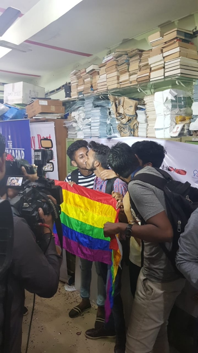 Couples kiss and celebrate the Supreme Court's verdict.