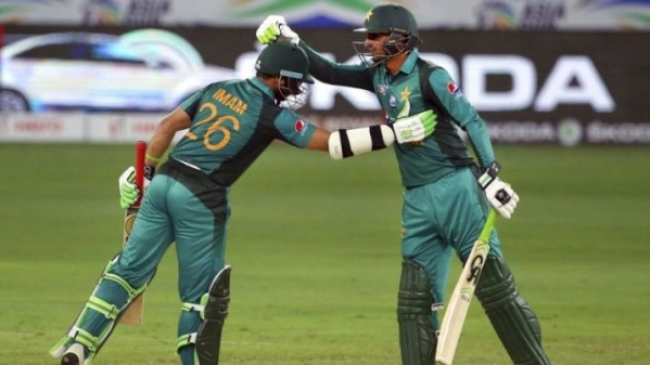 Shoaib Malik (left) and Imam-ul-Haq in action against Afghanistan in the Asia Cup on Friday.