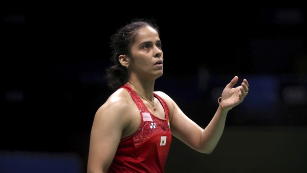 Saina Nehwal has been knocked out of the Korea Open by Nozomi Okuhara.