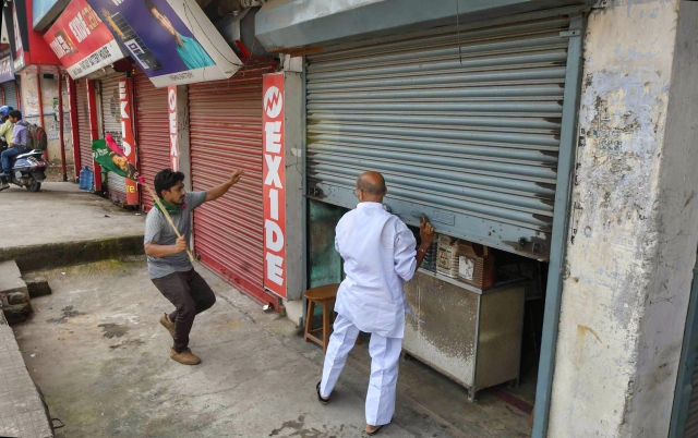Jan Adhikar Party supporters shut shops during Bharat Bandh.
