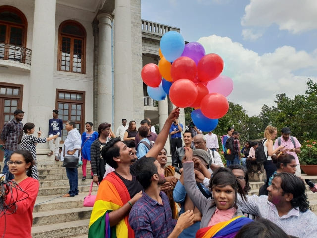 Supporters of the LGBTQ community in Bengaluru celebrate with balloons, following SC's verdict.