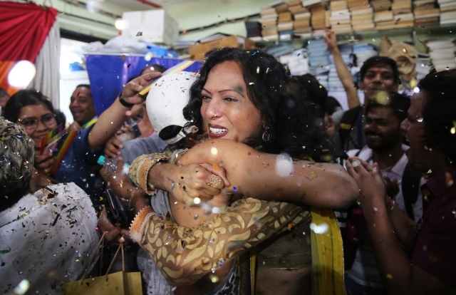 Supporters of the LGBTQ community in Mumbai hug each other following the SC's verdict.
