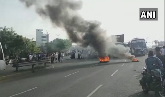 Protesters burn tyres in Gujarat's Bharuch.