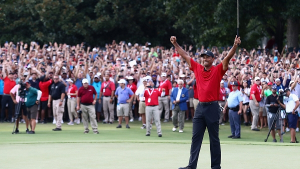 Tiger Woods celebrates his first title in five years, at the Tour Championship.