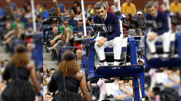 Chair umpire Carlos Ramos talks with Serena Williams during the women's final of the US Open tennis tournament against Naomi Osaka.