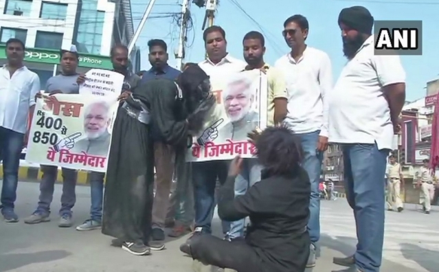 Congress workers protested in Raipur against fuel price hike.
