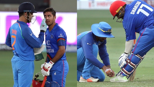 India's MS Dhoni and Dinesh Karthik give Afghanistan's Najibullah Zadran and Mohammad Shahzad a helping hand during the Asia Cup.