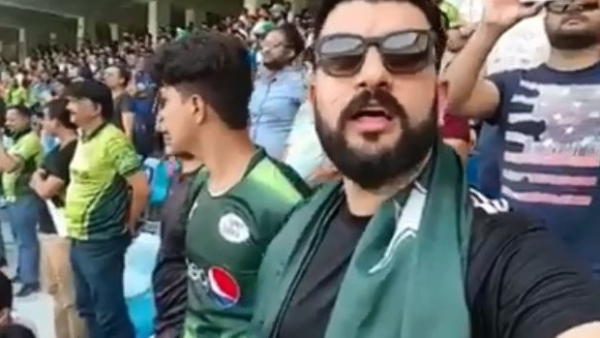 A Pakistani cricket fan is seen singing the Indian national anthem.