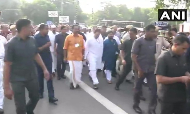 Congress President Rahul Gandhi leads the protest march in Delhi.