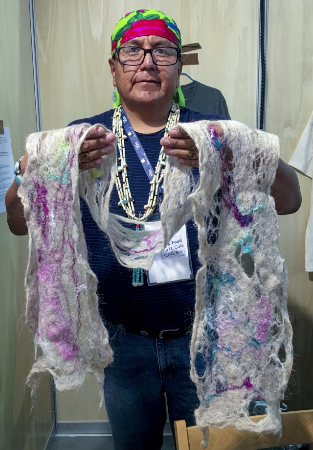 Roy Kady from Arizona, USA, with his hand-felted scarves.