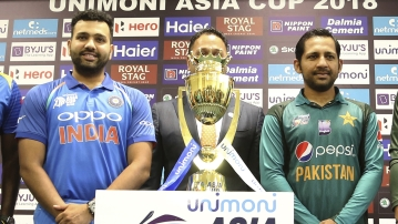 Captains of India Rohit Sharma, left, and Pakistan Sarfraz Ahmed pose with the winners trophy before the start of the Asia Cup. The two teams will face off on Tuesday in Dubai.