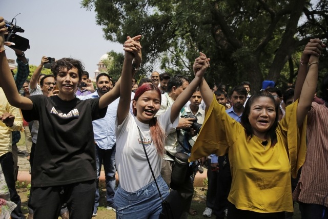 Members of the Nazariya foundation celebrate the apex court's verdict in New Delhi on Thursday.