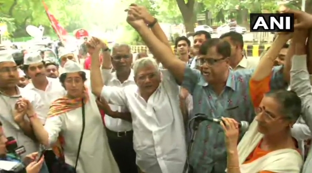 Left leaders Sitaram Yechury and D Raja with AAP leader Atishi.