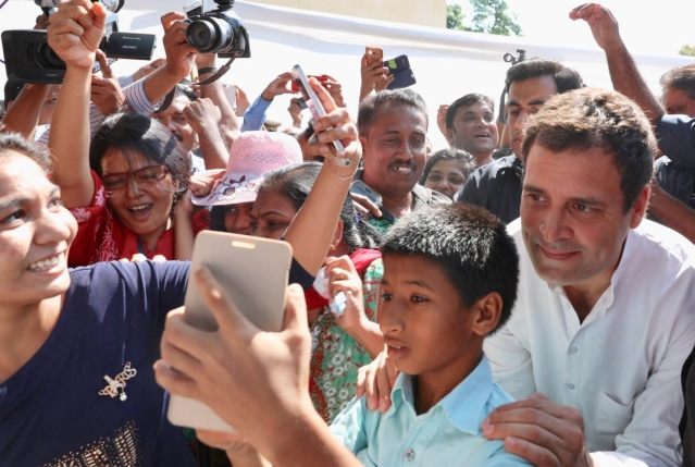 Congress President Rahul Gandhi clicks a selfie with an enthusiastic kid.