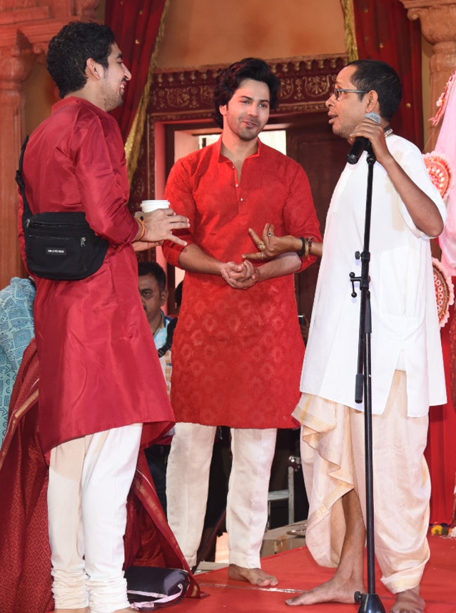 Ayan Mukerji and Varun Dhawan have a light moment with a priest.