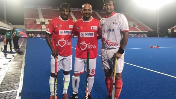 Former Indian hockey skipper Dilip Tirkey (right) and Dhanraj Pillay (left) during an exhibition match at the inauguration of refurbished Kalinga Stadium.