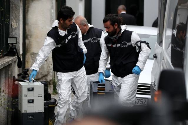 Turkish forensic police officers enter the Saudi consulate in Ankara.