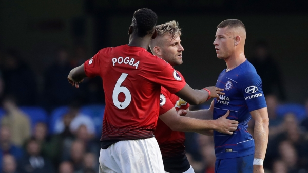 ManU defender Luke Shaw, center and Paul Pogba argue with Chelsea's Ross Barkley, right, after he scored his side's second goal.